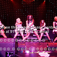 Danity Kane performing at The Hammerstein Ballroom on May 28, 2008. .Shannon Rae Bex - blonde -caucasion with black top..Aundrea Aurora Fimbres - brunette - caucasian with black top..Aubrey Morgan O'Day - blonde - caucasian with white top.Dawn Angelique Richard- long hair - African Am. with white top and long wavy hair..Wanita Denise Woodgette - shorter hair - African Am. with Grey top.
