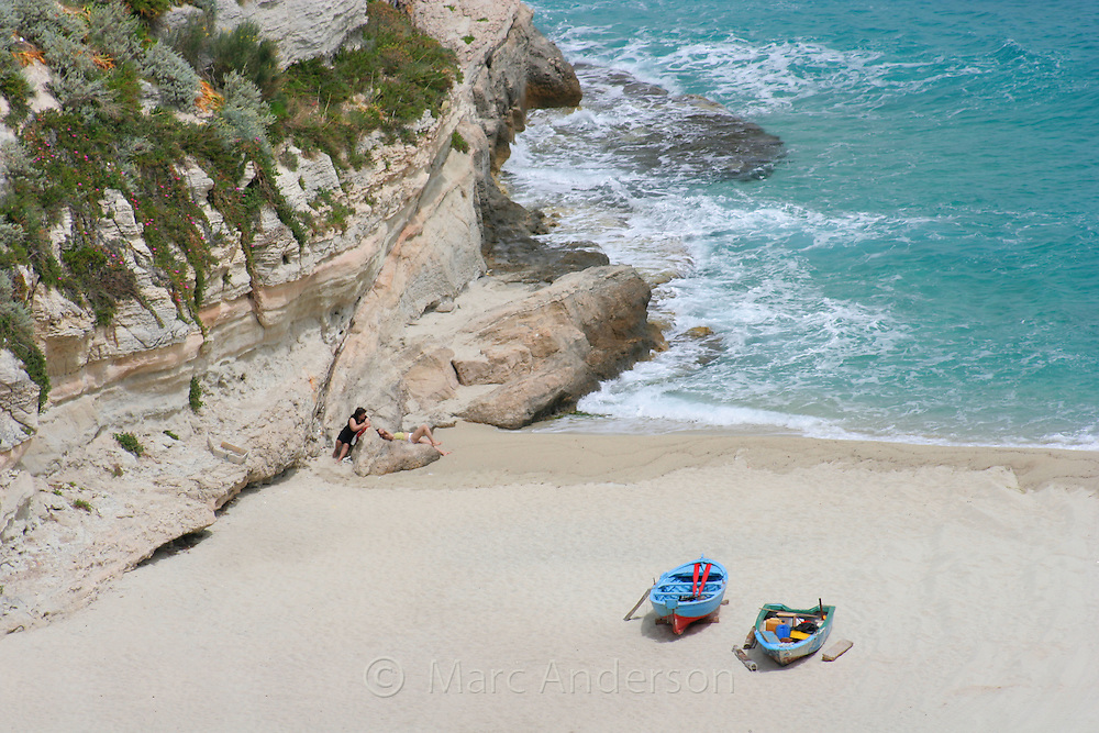 Colourful rowing boats on a sandy beach, Tropea, Italy