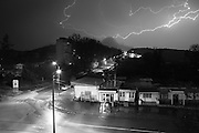 """A though thunderstorm at night above Shushi center. This image is part of the photoproject """"The Twentieth Spring"""", a portrait of caucasian town Shushi 20 years after its so called """"Liberation"""" by armenian fighters. In its more than two centuries old history Shushi was ruled by different powers like armeniens, persians, russian or aseris. In 1991 a fierce battle for Karabakhs independence from Azerbaijan began. During the breakdown of Sowjet Union armenians didn´t want to stay within the Republic of Azerbaijan anymore. 1992 armenians manage to takeover """"ancient armenian Shushi"""" and pushed out remained aseris forces which had operate a rocket base there. Since then Shushi became an """"armenian town"""" again. Today, 20 yeras after statement of Karabakhs independence Shushi tries to find it´s opportunities for it´s future. The less populated town is still affected by devastation and ruins by it´s violent history. Life is mostly a daily struggle for the inhabitants to get expenses covered, caused by a lack of jobs and almost no perspective for a sustainable economic development. Shushi depends on donations by diaspora armenians. On the other hand those donations have made it possible to rebuild a cultural centre, recover new asphalt roads and other infrastructure. 20 years after Shushis fall into armenian hands Babies get born and people won´t never be under aseris rule again. The bloody early 1990´s civil war has moved into the trenches of the frontline 20 kilometer away from Shushi where it stuck since 1994. The karabakh conflict is still not solved and could turn to an open war every day. Nonetheless life goes on on the south caucasian rocky tip above mountainious region of Karabakh where Shushi enthrones ever since centuries."""
