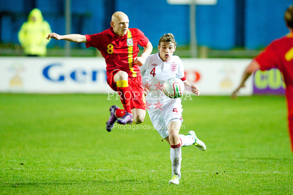 PORT TALBOT, WALES - Thursday, November 1, 2012: Wales' Lloyd Humphries in action against England's captain Ryan Ledson during the Under-16's Victory Shield match at Victoria Road. (Pic by David Rawcliffe/Propaganda)