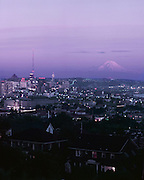 8385...WASHINGTON - A 1965 photograph of Seattle's skyline and Elliott Bay with Mount Rainier in the distance taken at sunset from Queen Anne Hill.