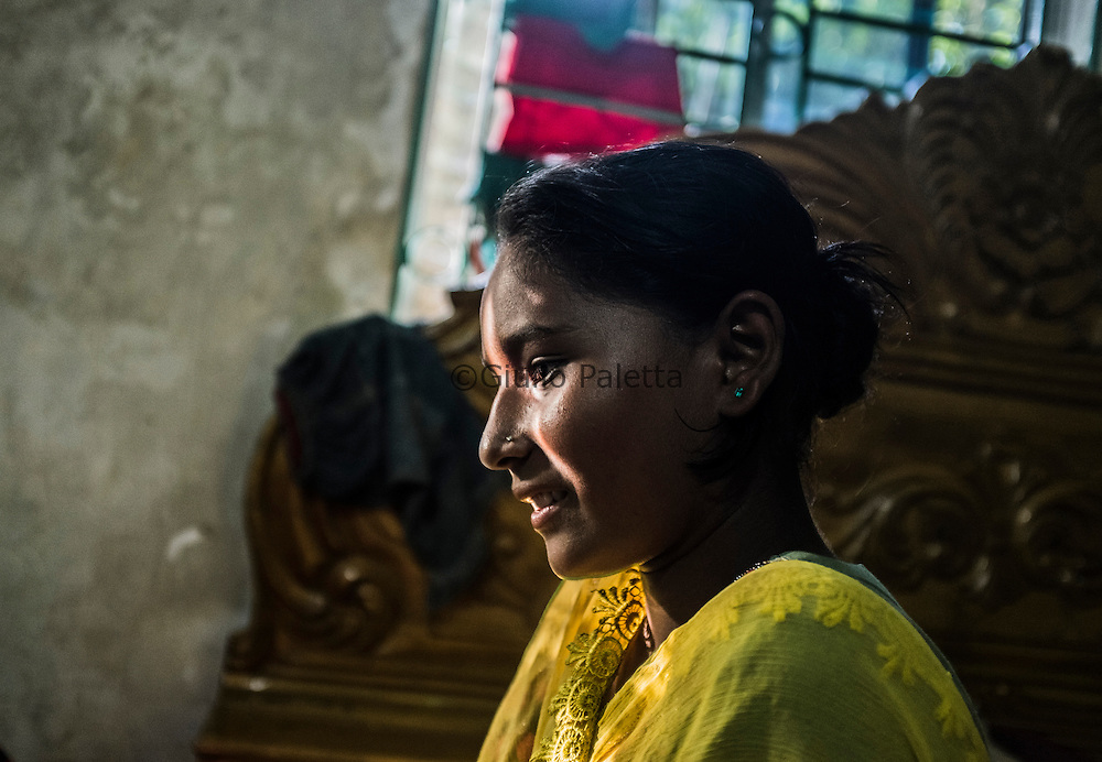 Sumi Akter, 13 years old, one of the surfer girls at her house in Cox's Bazar, Bangladesh. Her father works as a plumber while her mother is a housewife. Among the surfer girls, Sumi is the only one who has the luck to be able to go to school because her father can afford that
