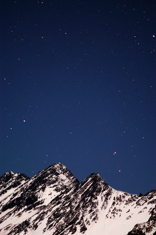 Night photo of  Andes mountains behind Laguna del Inca, Portillo. Chile.