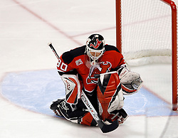 April 26, 2007; East Rutherford, NJ, USA; New Jersey Devils goalie Martin Brodeur (30) makes a save during the first period at Continental Airlines Arena in East Rutherford, NJ.