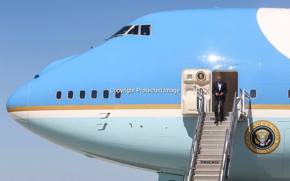President Barack Obama steps out of Air Force One upon his arrival at Los Angeles International Airport in Los Angeles on Saturday, Oct. 10, 2015.  (AP Photo/Ringo H.W. Chiu)