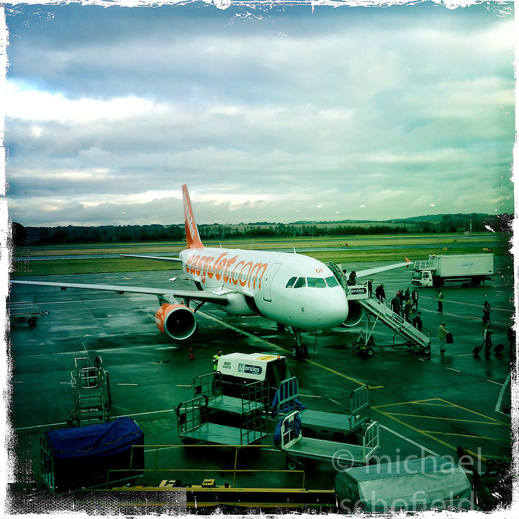 easyjet at Edinburgh airport..Hipstamatic images taken on an Apple iPhone..©Michael Schofield.