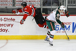 Mar 20, 2009; Newark, NJ, USA; Minnesota Wild defenseman Nick Schultz (55) hits New Jersey Devils right wing David Clarkson (23) during the third period at the Prudential Center.  The Devils defeated the Wild 4-0.