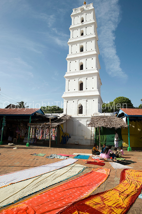 Minaret and courtyard of Dargah shrine. Sari's drying in the sun.