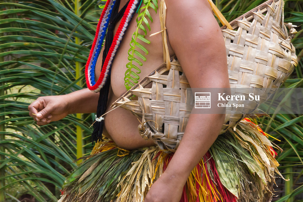 Yapese woman in traditional clothing carrying hand bag at Yap Day Festival, Yap Island, Federated States of Micronesia
