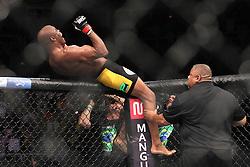 August 27, 2011; Rio De Janiero, Brazil; Anderson Silva (yellow/black trunks) celebrates his knockout win over Yushin Okami (white trunks) to retain his UFC Middleweight Championship at UFC 134 in Rio De Janiero.