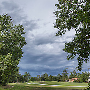 Storm clouds building on golf course in The Woodlands, Texas in summer.