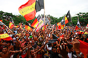Fretilin supporters parade down the streets in Dili, Timor-Leste and cheer for Fretilin Party candidate Francisco Lu Olo Guterres during a political rally on the last day of campaigning before Timorese go to the polls in 3 days to elect a president for the third time since the restoration of Independence, on March 14, 2012. Photo by Martine Perret