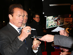 Arnold Schwarzenegger signs autographs  at The Last Stand premiere in London, Tuesday, 22nd January 2013.  Photo by: Stephen Lock / i-Images