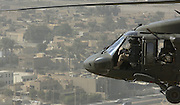 A US Army (USA) UH-60 Black Hawk helicopter in flight over the city of Baghdad, Iraq during Operation IRAQI FREEDOM.