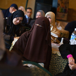 Students listen to Amr Khaled giving a speech in Mansoura, Egypt, Dec. 27, 2005. Khaled says the town is one of Life Makers most powerful chapters. The Islamic televangelist and former accountant, had previously been asked to leave Egypt as his revival gained strength. As a result he started preaching on several television shows, turning him into an international celebrity. Some religious scholars complain that Khaled has not been properly trained in Islam to command such a following.
