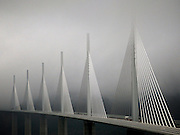 In the late afternoon, as mist and fog descended, a soft light shone through to illuminate the structure of the Millau Viaduct, South West France