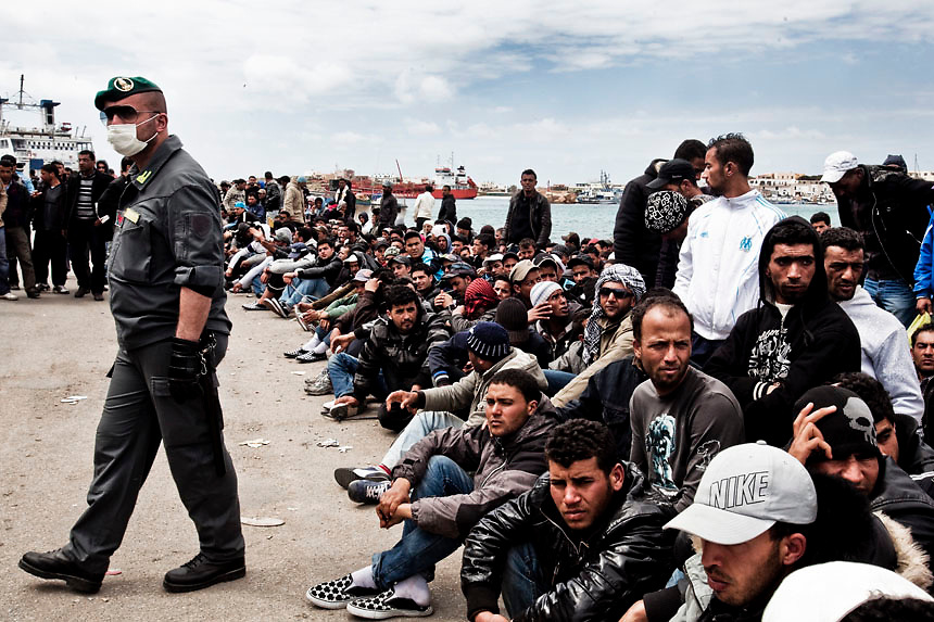 Tension rises as Northern African would be immigrants prepares to go to the identification centre of Lampedusa. Italian government promised to evacuate the Island, currently overpacked with more than 6000 immingrants living in critical igienic and sanitary conditions, by sending 5 ferry boats.