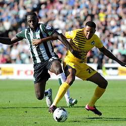 Hiram Boateng of Plymouth Argyle challenges Christian Montano of Bristol Rovers - Mandatory byline: Neil Brookman/JMP - 07966 386802 - 19/09/2015 - FOOTBALL - Home Park - Plymouth, England - Plymouth Argyle v Bristol Rovers - Sky Bet League Two