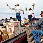 Auctioneers sell tools at a farm auction in eastern Colorado