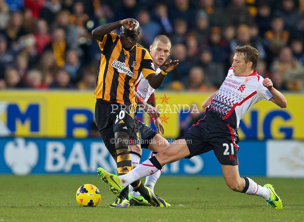 HULL, ENGLAND - Sunday, December 1, 2013: Liverpool's Lucas Leiva in action against Hull City's Yannick Sagbo during the Premiership match at the KC Stadium. (Pic by David Rawcliffe/Propaganda)