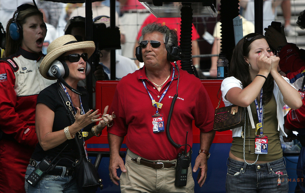 Relatives of Marco Andretti react after he was passed by Sam Hornish Jr. on the run to the checkered flag during the 90th running of the Indianapolis 500 auto race, at the Indianapolis Motor Speedway on Sunday, May 28, 2006, in Indianapolis. Grandfather Mario Andretti is at center, mother Sandy Spinozzi Andretti is second from left, and sister Marissa Andretti is at right. Hornish won, and Marco Andretti finished second. ....