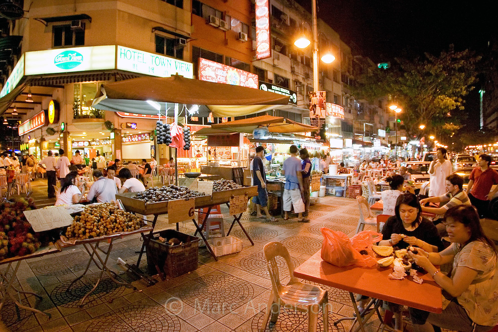 Street food stalls and restaurants at night in Kuala Lumpur, Malaysia.