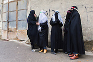 Veiled muslim women, wearing traditional black chadors, mourning during the Day of Ashura, the most important event of the year for shi'a muslims. Bijar, Kurdistan Province, Iran.<br />