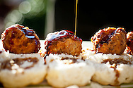 Steen's Cane Syrup drenches boudin balls and bacon on a biscuit to make the Sweet Baby Breesus. A breakfast item created by chef Justin Girouard to honor New Orleans Saints quarterback Drew Brees.