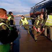 Ground crew members of Red Arrows Royal Air Force aerobatic team refuel the team's Hawks between training flights,