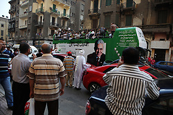 People in downtown Cairo were surprised to see the bus pass..