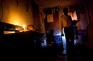 A prayer session is held by candlelight in the basement of a house on July 5, 2010 in Port-au-Prince, Haiti. Many churches were destroyed by the earthquake, and congregations are forced to rely on makeshift spaces for the time being.