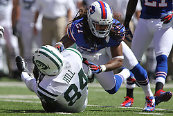 Sept 9, 2012; East Rutherford, NJ, USA; Buffalo Bills defensive back Stephon Gilmore (27) tackles New York Jets wide receiver Stephen Hill (84) during the first half at MetLIfe Stadium.