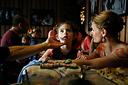 MELISSA LYTTLE       Times<br /> SP_351237_LYTT_TWINS_19 (March 30, 2012, Clearwater, Fla.) Jon Scheinman reaches out to comfort Olivia, while Allison looks on with concern, after noticing Olivia's chin quivering and the onset a small seizure during dinner at one of their favorite pizza places. It's a huge undertaking to go out as a family, but they've found places near their house that they're comfortable in and have become regulars at. [MELISSA LYTTLE, Times]