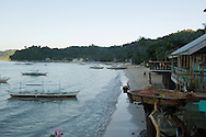 A view of El Nido Town's beach just before sunset as seen from a restaurant with an interesting perch.