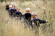 East Ruston Primary School and their nature areas which won in the Norfolk Biodiversity Awards, pictured Spencer Pull leading other  reception class pupils in the meadow.<br /> <br /> Picture: MARK BULLIMORE