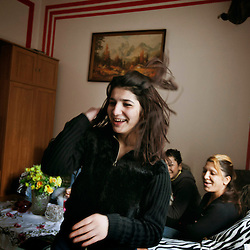 "A relative of Denisa Holubova dances in their home in Ostrava, Czech Republic on Feb. 27, 2012. Denisa was one of 18 Roma children who were represented in the D.H. and Others v. Czech Republic case, the first challenge to systemic racial segregation in education to reach the European Court of Human Rights. When this case was first brought in 2000, Roma children in the Czech Republic were 27 times more likely to be placed in ""special schools,"" intended for the mentally disabled, than non-Roma children. In 2007, the Grand Chamber of the European Court of Human Rights ruled that this pattern of segregation violated nondiscrimination protections in the European Convention on Human Rights. Despite this landmark decision, little change has occurred: the ""special schools"" have been renamed but follow the same substandard curriculum and Roma continue to be assigned to these schools in disproportionate numbers. The process of integration has barely begun."