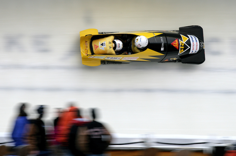 (November 21, 2009) Maya Bamert and Caroline Spahni of Switzerland fly through the 'Shady' corner enroute to a 11th place finish in the two-man bobsled at  the Federation Internationale de Bobsleigh et de Togogganing (FIBT) two-man men's bobsled World Cup race at the Olympic Sports Complex in Lake Placid, New York.