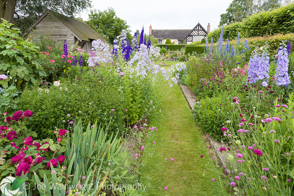 Wollerton Old Hall Garden, near Market Drayton, Shropshire, has been designed and developed by Lesley and John Jenkins.  Work began in 1984 in the grounds of a 16th century house.  Visitors to Wollerton Old Hall are immediately struck by the attractive layout – one which entices you explore and discover one hidden gem of garden design after another.  The planting is also lush, sumptuous, colourful and fragrant.  Nothing is out of scale; no structure or garden section dominates or overwhelms the others – and the transition from one garden 'room' to another is totally seamless and natural. This photograph was taken in June.