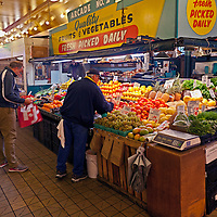 WA09562-00...WASHINGTON - Fruit and vegetable stand at the Pike Place Market in Seattle.