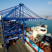 A crane unloads cargo containers from a ship at BNCT.