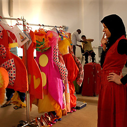 A young woman helps select clothes for models backstage during FestiMode in Casablanca, Morocco on May 8, 2009.