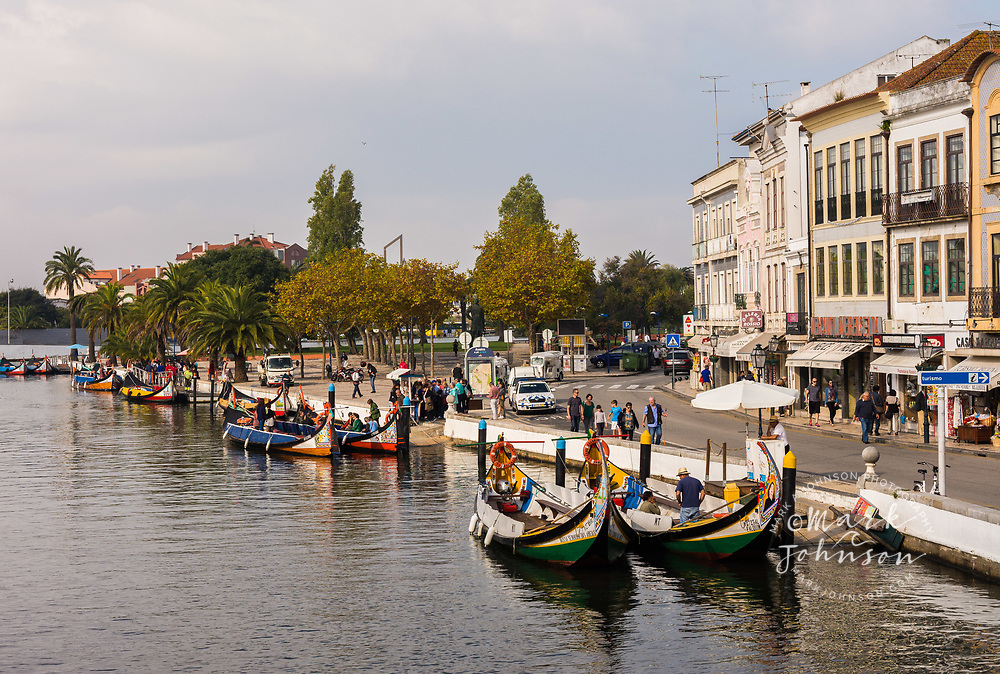 Tourist Moliceiro sightseeing boats on the canals of Aveiro, Portugal
