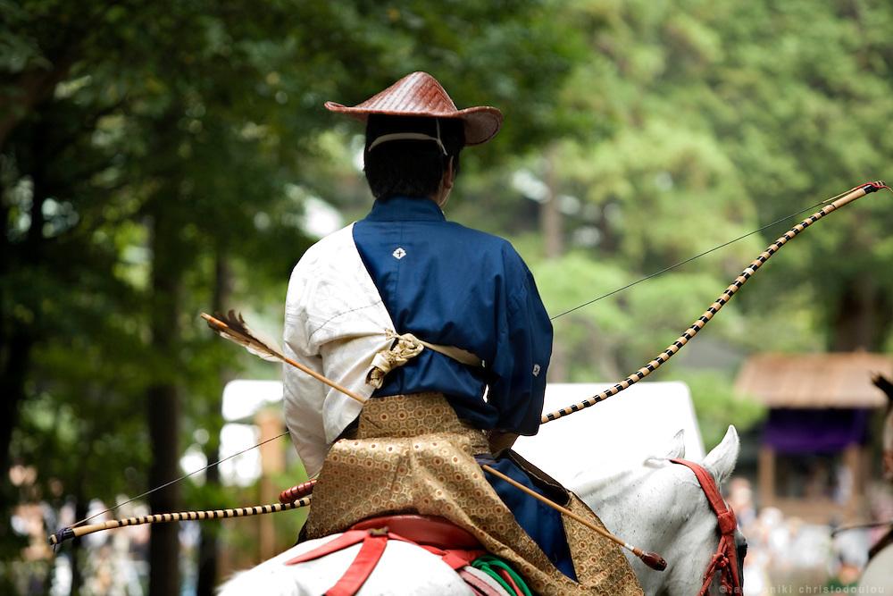 Kiyomoto Ogasawara leaving the Yabusame track at the end of Yabusame (horse-riding archery shinto ritual), on the 3rd day of the 3-day anual festival of Tsurugaoka Hachimangu shrine in Kamakura.