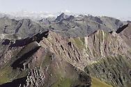 Typical red soil of the peaks of the cabecera de Arag&oacute;n Subord&aacute;n, puerto de Acherri, Pyrenees, Huesca, Aragon, Spain<br />