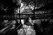 An old stone footbridge crosses the river Afon Gwynant, surrounded by small stunted trees. Very middle earth, the troll lives beneath the bridge.