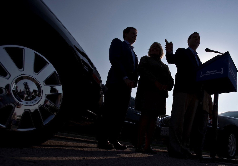 Ontario PC leader Tim Hudak, right, is silhouetted during an early morning campaign stop in London Ontario, Tuesday, September 13, 2011.<br /> THE CANADIAN PRESS/ Geoff Robins