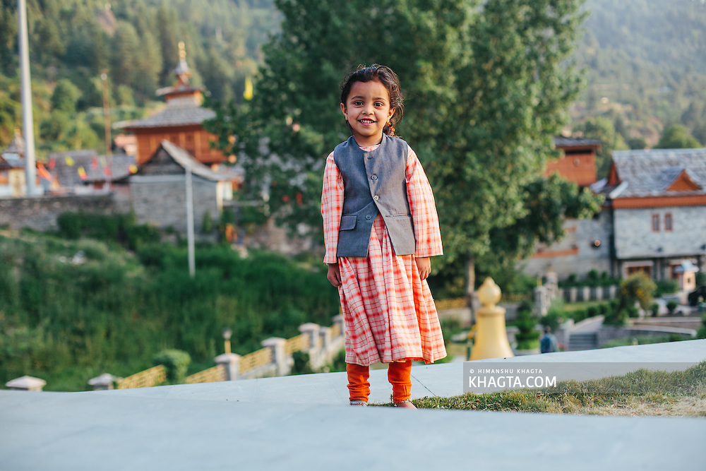 A cute kid dressed in Traditional Himachali Clothes posing for the camera at Sarahan, Shimla, Himachal Pradesh