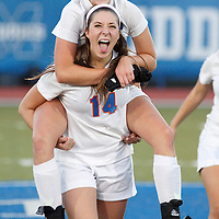 S.S. Seward's Maggie Paras (14) and teammate Sinead Brosman celebrate their team's victory over Tuxedo in the Section 9 Class C championship game at Faller Field in Middletown on Wednesday, Oct. 30, 2013.