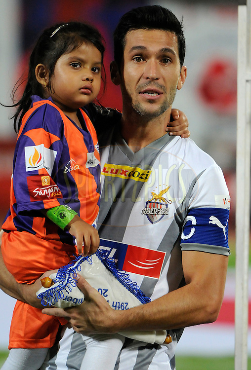 Luis Javier Garcia Sanz of Atletico de Kolkata holds a ceremony kid during the national anthem before the start of match 44 of the Hero Indian Super League between FC Pune City and Atletico de Kolkata FC held at the Shree Shiv Chhatrapati Sports Complex Stadium, Pune, India on the 29th November 2014.<br /> <br /> Photo by:  Pal Pillai/ ISL/ SPORTZPICS