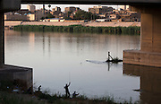 Iraq men fish the Tigris river at dusk under the al-Sinak bridge in downtown Baghdad, Iraq  August 26, 2010.   .